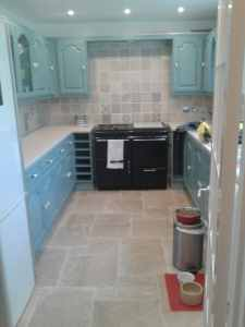 wall and floor tiling and kitchen cupboard painting